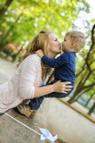 Parent touching noses with her son and smiling Royalty Free Stock Photo