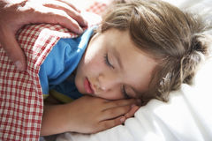 Parent Waking Young Boy Asleep In Bed Royalty Free Stock Images