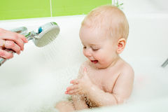 Parent washing baby in bathroom Royalty Free Stock Photos