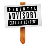 Parental advisory label on wooden post Stock Photography
