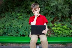 Parental advisory, parental control. Shocked boy sitting with ta stock photo