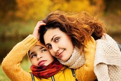 Parental Care and Love Concept. Cheerful Family Outdoors. Parental Care and Love Concept royalty free stock photo