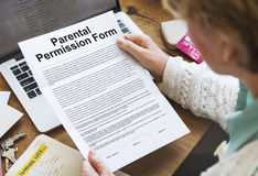 Parental Permission Form Contract Concept. Reading Parental Permission Form Contract Stock Photography