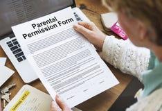 Parental Permission Form Contract Concept. Reading Parental Permission Form Contract stock photography