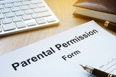 Parental Permission Form on a table. Parental Permission Form on a wooden table Royalty Free Stock Images