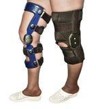 Parentesi graffe di ginocchio Fotografie Stock