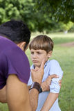 Parenthood and children education, angry man scolding boy in par Royalty Free Stock Photography