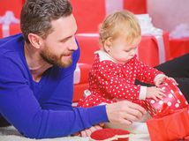 Parenthood goals. Endless love. Parenthood as challenge and achievement. Father play with cute baby toddler daughter. Celebrate first birthday. Happy stock images