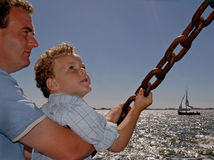 Parenting. Father and son at sea, father holding his son tight Stock Photo