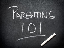 Parenting course. On black board with chalk Stock Photo
