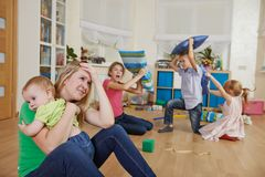 Parenting and family frustration. Female parent women frustrated and upset from children behaviour Royalty Free Stock Photos