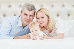 Parenting family. Mother and father playing with little newborn baby Stock Photos