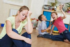 Parenting and family problem. Exhausted mother frustrated and upset from children behaviour Stock Photos
