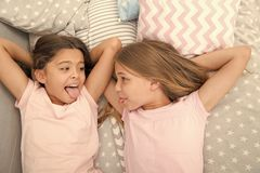Parenting and family relations of happy small girls in bedroom. family and parenting concept. small girls have fun stock image