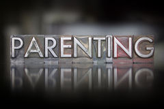 Parenting Letterpress. The word Parenting written in vintage letterpress type royalty free stock photo