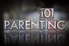 Parenting 101 Letterpress. The words Parenting 101 written in vintage letterpress type stock photo