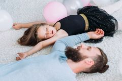 Parenting lifestyle tired father asleep daughter stock image