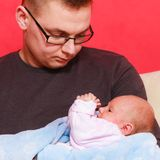 Father holding taking care of newborn baby Royalty Free Stock Photo