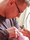 Father holding taking care of newborn baby Royalty Free Stock Photography