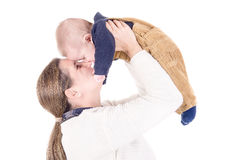 Parenting. Mother with little baby isolated in white Stock Photos