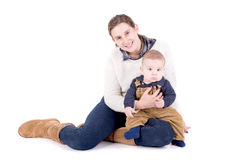 Parenting. Mother with little baby isolated in white Stock Photography