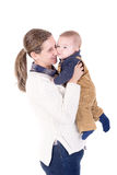 Parenting. Mother with little baby isolated in white Stock Images