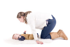 Parenting. Mother with little baby isolated in white Royalty Free Stock Photo