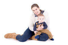 Parenting. Mother with little baby isolated in white Royalty Free Stock Photos