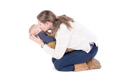 Parenting. Mother with little baby isolated in white Royalty Free Stock Photography