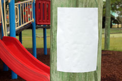 Parenting Notice. Blank sign in a children's playground awaiting details of your parenting event stock images