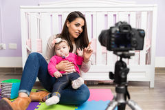 Parenting video blogger at work Stock Images