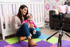 Parenting video blogger at work Stock Photo
