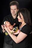 Parents Admiring Newborn Stock Image