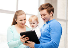 Parents and adorable baby with tablet pc Stock Photo