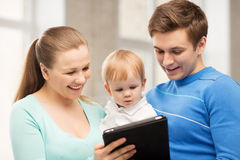 Parents and adorable baby with tablet pc Royalty Free Stock Photos