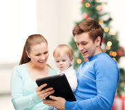 Parents and adorable baby with tablet pc Royalty Free Stock Images