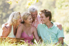 Parents with adult children on picnic Stock Photo