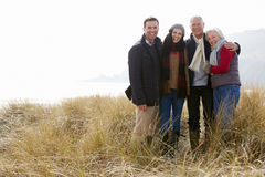 Parents With Adult Offspring Standing In Dunes Stock Photos