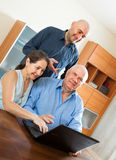 Parents with adult son in internet Royalty Free Stock Photo