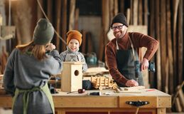 Free Parents And Kid Making  Wooden Bird House In Craft Workplace Royalty Free Stock Images - 219673119