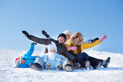 Free Parents And Kids On Snowy Hill Stock Photography - 23087252