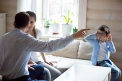 Parents having fight with presence of little kid. Parents argue at home in presence of small child, spouses have fight let little son hear dispute or quarrel stock image