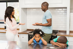 Parents arguing in front of children. In the kitchen Royalty Free Stock Photo