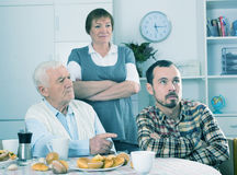 Parents arguing with son. Aged parents arguing with their adult son at home royalty free stock photography