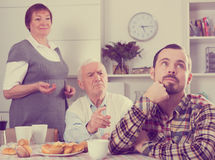 Parents arguing with son Royalty Free Stock Images