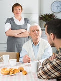 Parents arguing with son. Father and mother having disagreement with adult son at home Stock Image