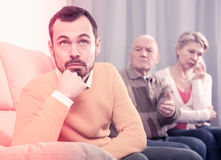 Parents arguing with son. Father and mother having disagreement with adult son at home Stock Photography