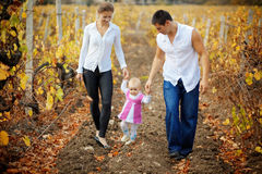 Parents with baby in autumn Stock Photography