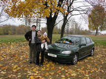 Parents with baby and car and autumn. Tree Royalty Free Stock Photos