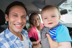 Parents and baby on a drive Royalty Free Stock Photography